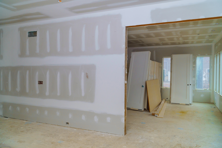 construction of housing with drywall installed door for a new home before installing